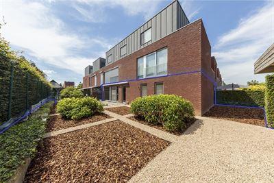 Modern gelijkvloers appartement met ruime tuin te Elewijt