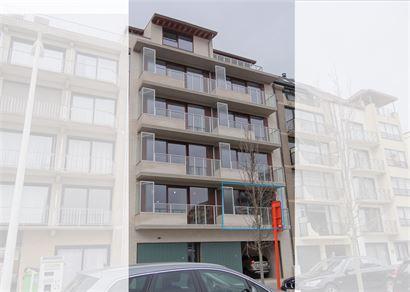 TE HUUR OP JAARBASIS - nieuw ongemeubeld woonappartement - centrale ligging - zonneterras - living met open keuken - 2 slaapkamers - badkamer met inlo...