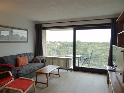 De Nereiden E 0405 - Gezellig en zonnig appartement met slaapkamer - Fantastisch open zicht op de duinen van op de vierde verdieping - Inkom - Leefrui...